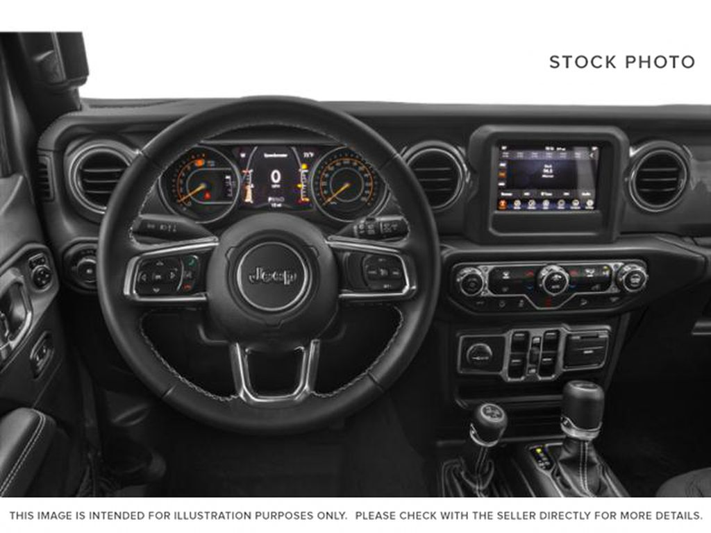 Black[Black] 2020 Jeep Wrangler Unlimited Steering Wheel and Dash Photo in Fort Macleod AB