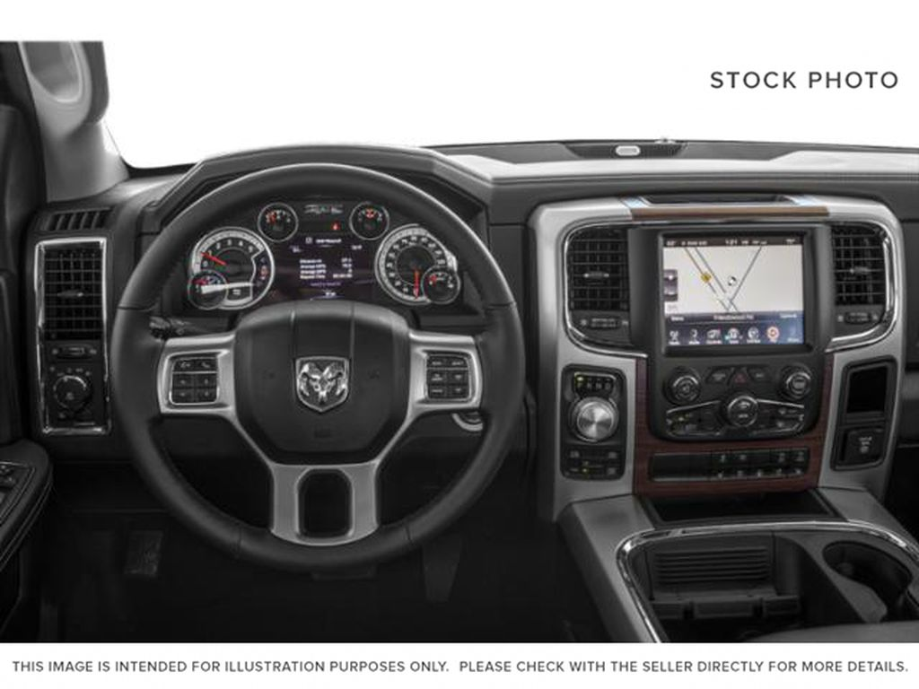 White[Bright White] 2018 Ram 1500 Steering Wheel and Dash Photo in Fort Macleod AB