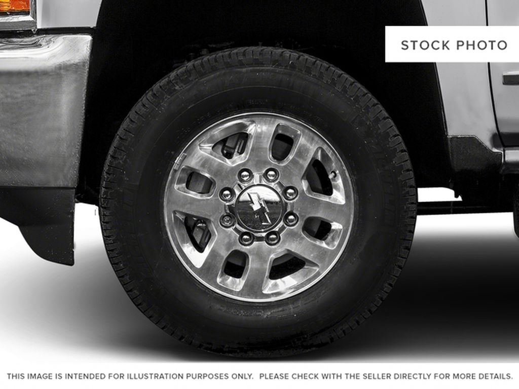 White[Summit White] 2016 Chevrolet Silverado 2500HD Left Front Rim and Tire Photo in Fort Macleod AB
