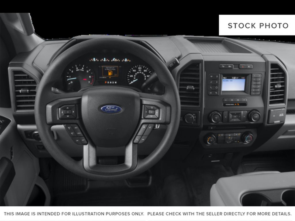 White[Oxford White] 2018 Ford F-150 Steering Wheel and Dash Photo in Fort Macleod AB