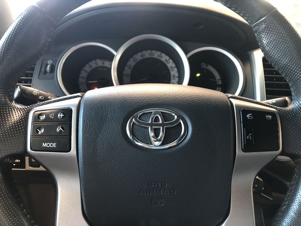 Grey 2012 Toyota Tacoma TRD Sport Left Front Head Light / Bumper and Grill in Edmonton AB
