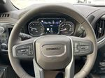 Gray[Dark Sky Metallic] 2021 GMC Sierra 1500 Denali Steering Wheel and Dash Photo in Calgary AB