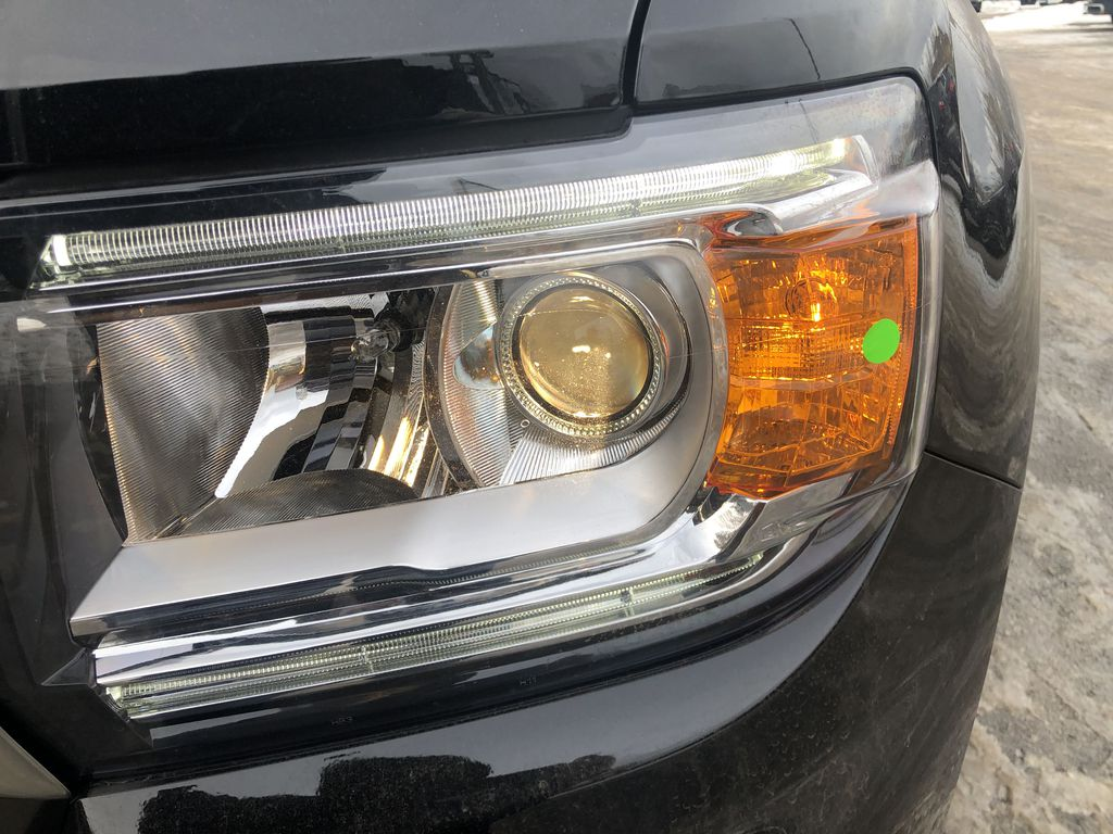 Black[Onyx Black] 2021 GMC Canyon AT4 Left Front Head Light / Bumper and Grill in Canmore AB