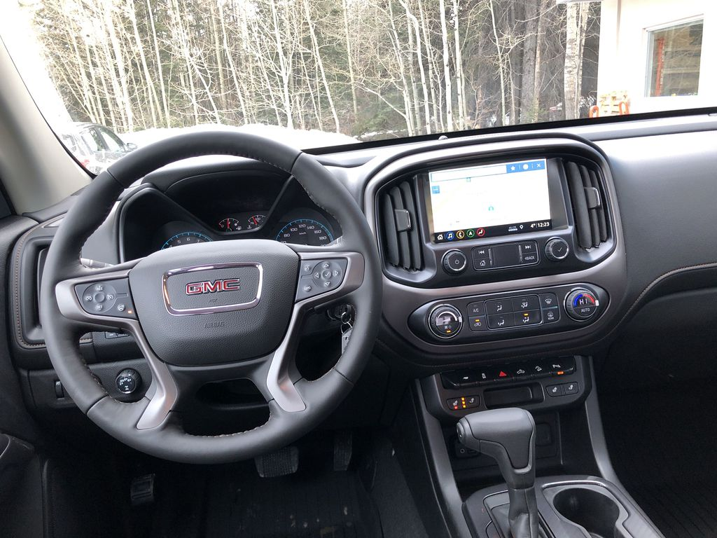 Black[Onyx Black] 2021 GMC Canyon AT4 Strng Wheel/Dash Photo: Frm Rear in Canmore AB