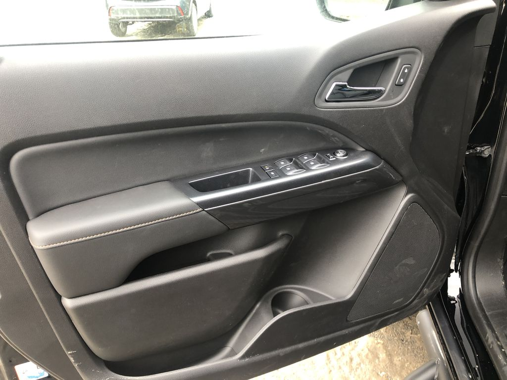 Black[Onyx Black] 2021 GMC Canyon AT4 Left Front Interior Door Panel Photo in Canmore AB