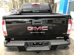 Black[Onyx Black] 2021 GMC Canyon AT4 Rear of Vehicle Photo in Canmore AB