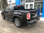 Black[Onyx Black] 2021 GMC Canyon AT4 Left Rear Corner Photo in Canmore AB