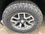 Black[Onyx Black] 2021 GMC Canyon AT4 Left Front Rim and Tire Photo in Canmore AB