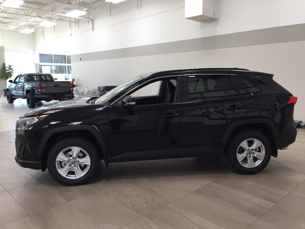 Black[Midnight Black Metallic] 2021 Toyota RAV4 XLE AWD Left Side Photo in Sherwood Park AB