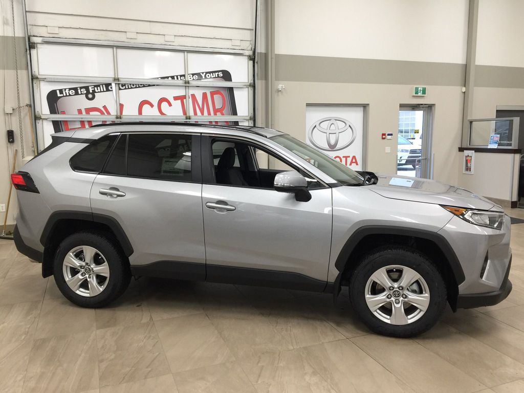 Silver[Silver Sky Metallic] 2021 Toyota RAV4 XLE AWD Right Side Photo in Sherwood Park AB