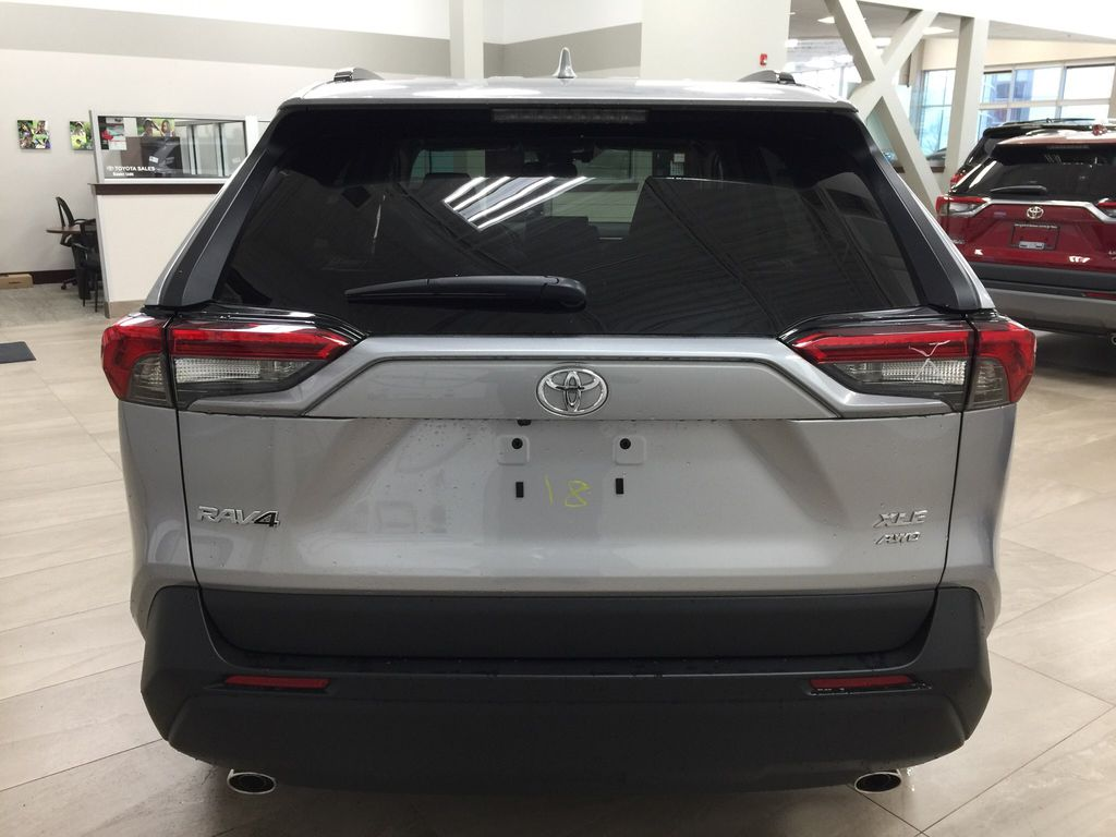Silver[Silver Sky Metallic] 2021 Toyota RAV4 XLE AWD Rear of Vehicle Photo in Sherwood Park AB
