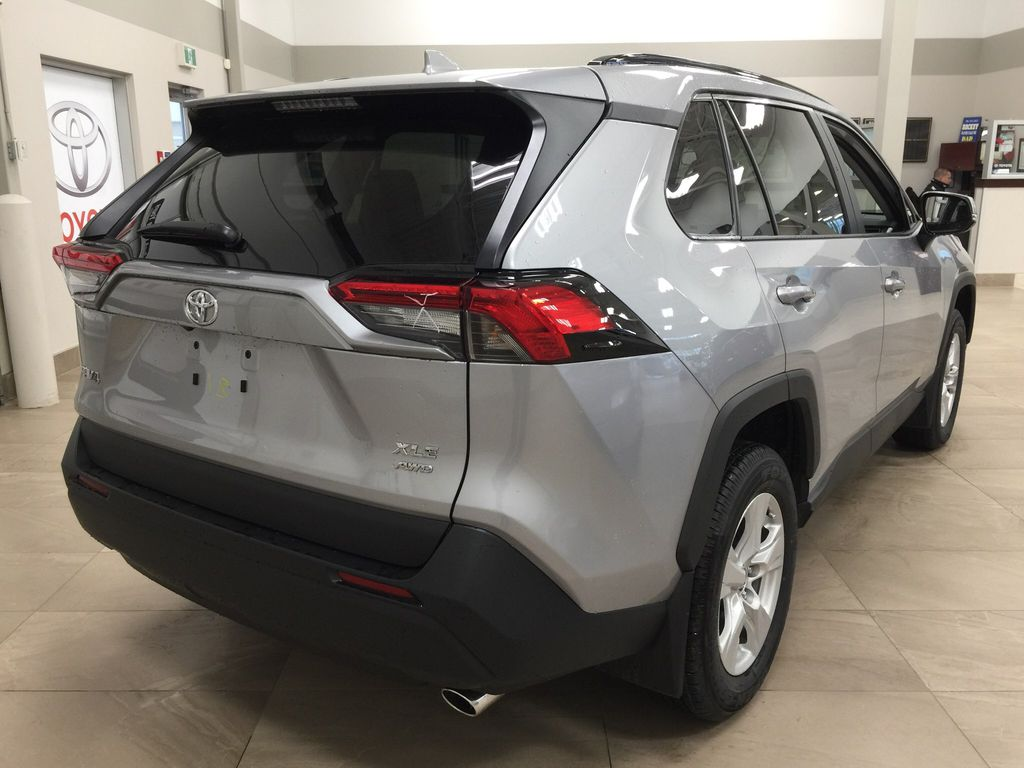 Silver[Silver Sky Metallic] 2021 Toyota RAV4 XLE AWD Right Rear Corner Photo in Sherwood Park AB