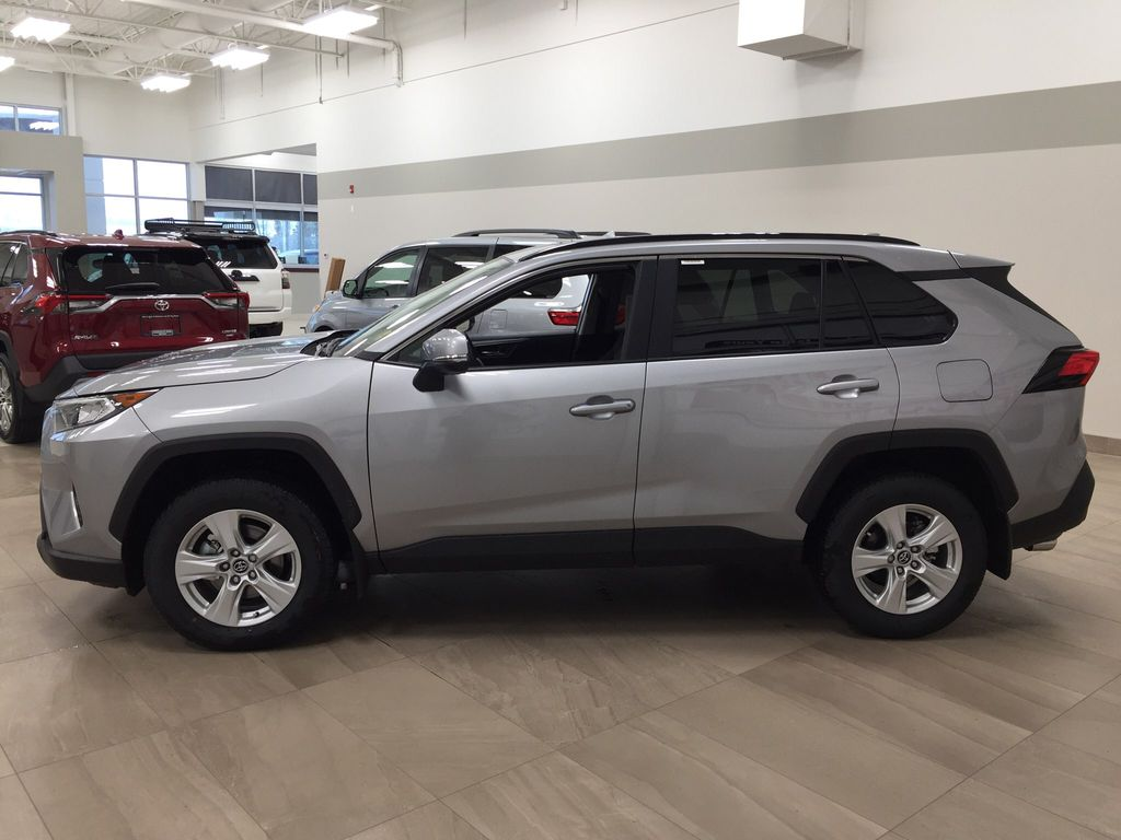 Silver[Silver Sky Metallic] 2021 Toyota RAV4 XLE AWD Left Side Photo in Sherwood Park AB