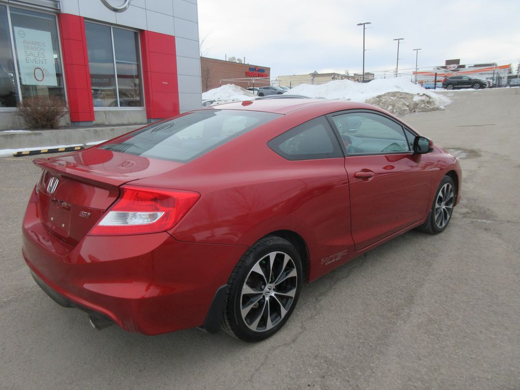 Orange[Sunburst Orange Pearl] 2013 Honda Civic Cpe Steering Wheel and Dash Photo in Okotoks AB