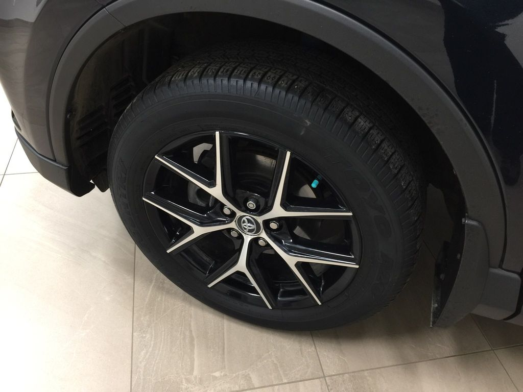 Blue[Galactic Aqua Mica] 2018 Toyota RAV4 SE AWD Left Front Rim and Tire Photo in Sherwood Park AB