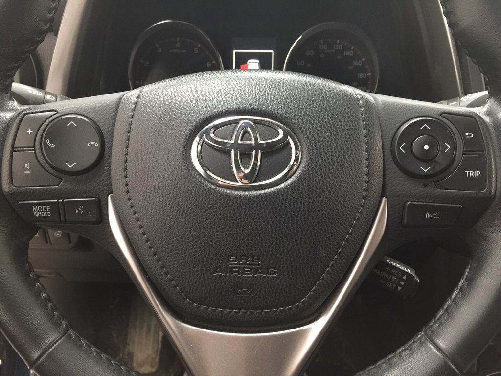 Blue[Galactic Aqua Mica] 2018 Toyota RAV4 SE AWD Steering Wheel and Dash Photo in Sherwood Park AB