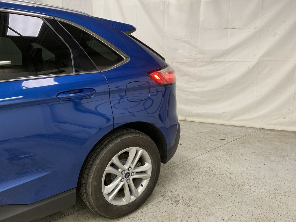 Blue[Atlas Blue Metallic] 2020 Ford Edge Left Rear Corner Photo in Dartmouth NS