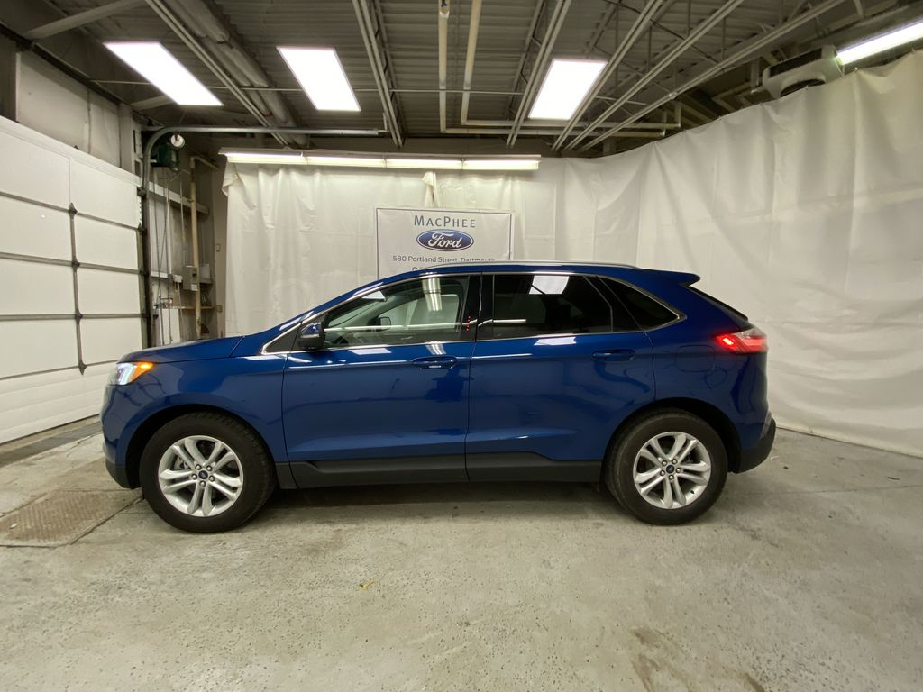 Blue[Atlas Blue Metallic] 2020 Ford Edge Left Side Photo in Dartmouth NS