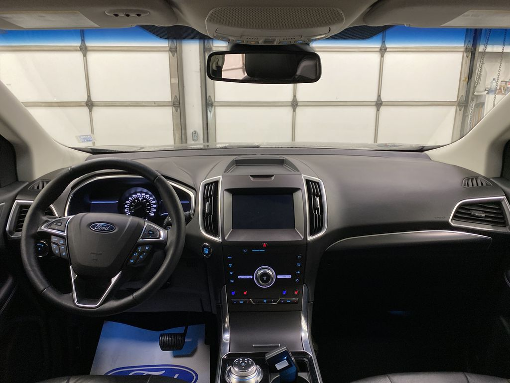 Silver[Iconic Silver Metallic] 2020 Ford Edge Strng Wheel/Dash Photo: Frm Rear in Dartmouth NS