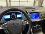 Silver[Iconic Silver Metallic] 2020 Ford Edge Steering Wheel and Dash Photo in Dartmouth NS