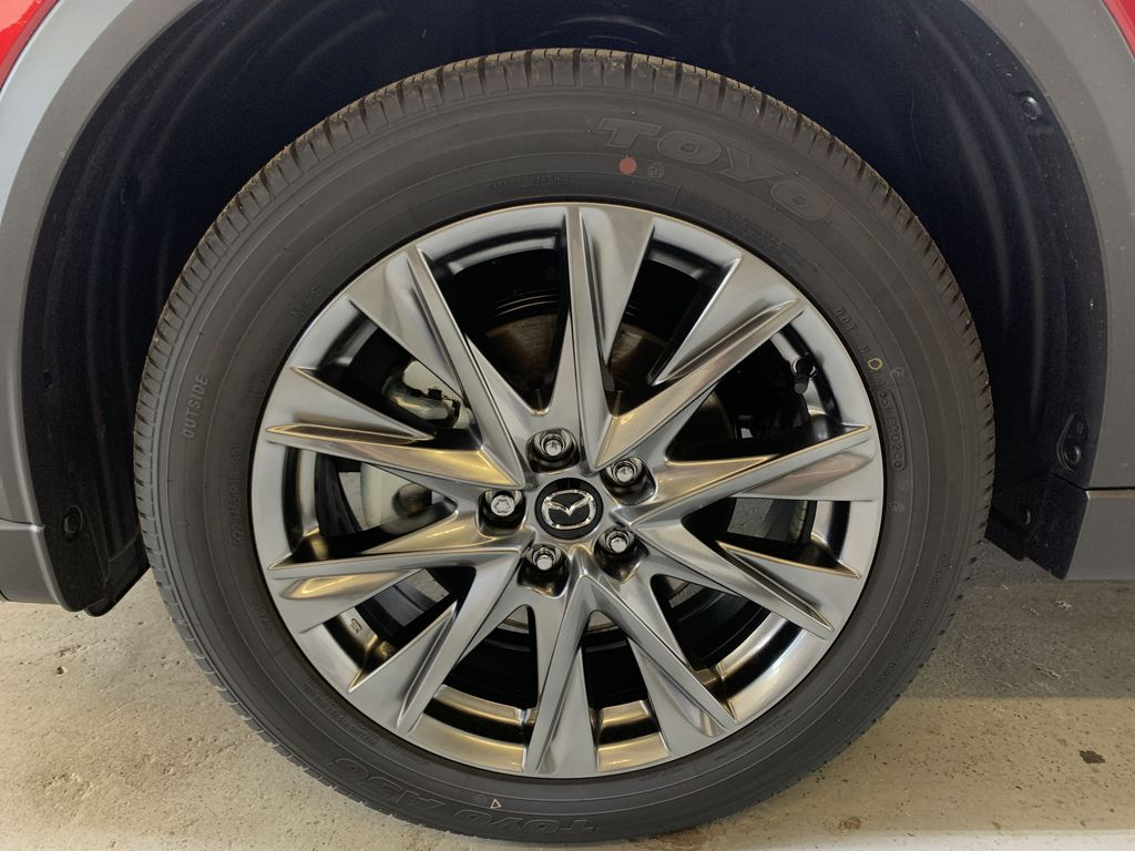 SOUL RED CRYSTAL METALLIC(46V) 2021 Mazda CX-5 Signature Left Front Rim and Tire Photo in Edmonton AB