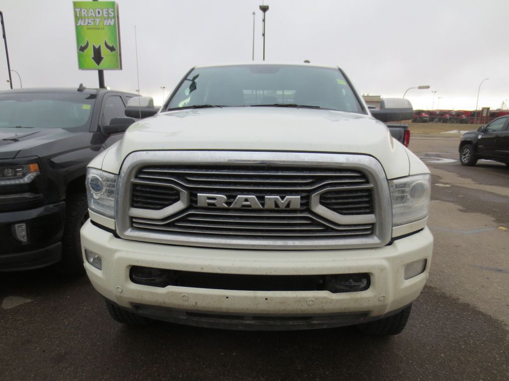 White 2017 Ram 3500 Left Front Rim and Tire Photo in Lethbridge AB