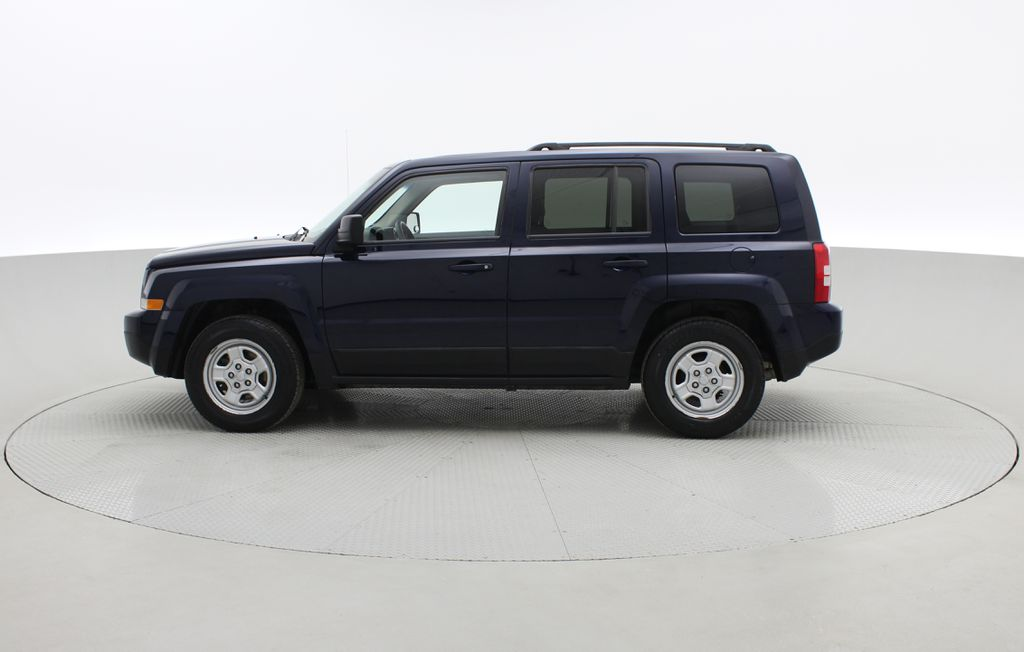 Blue[True Blue Pearlcoat] 2014 Jeep Patriot North - Alloy Wheels, AUTO, ALL CREDIT APPROVED Left Side Photo in Winnipeg MB