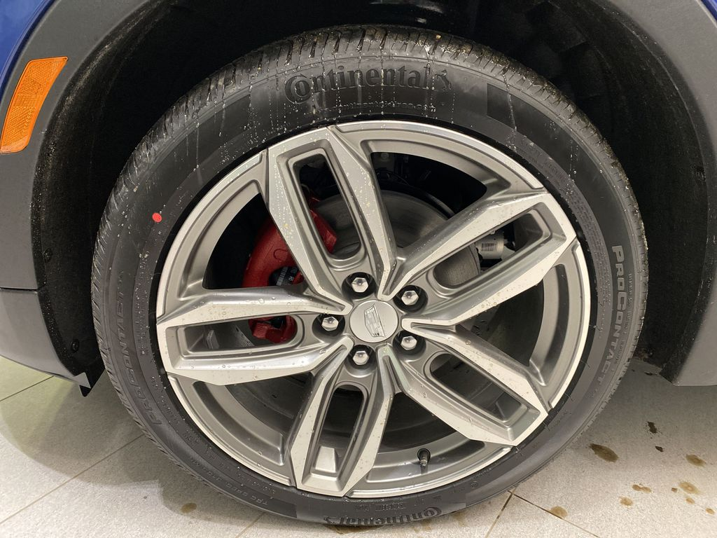Blue[Wave Metallic] 2021 Cadillac XT4 Left Front Rim and Tire Photo in Edmonton AB