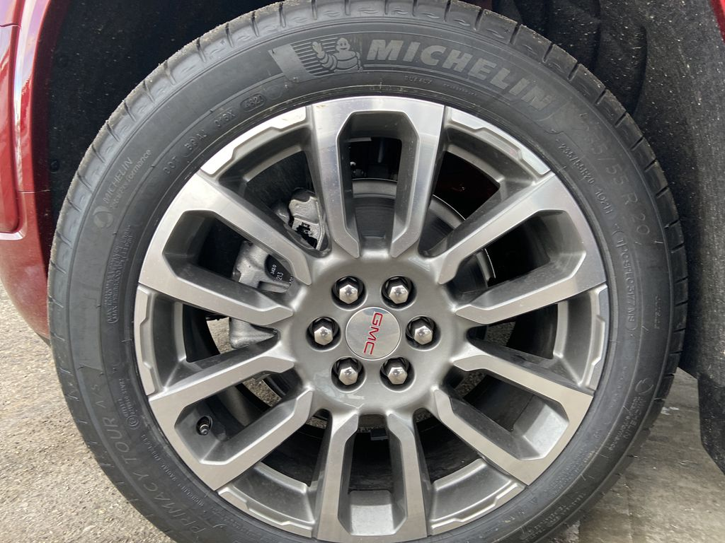 Red[Cayenne Red Tintcoat] 2021 GMC Acadia Denali Left Front Rim and Tire Photo in Calgary AB