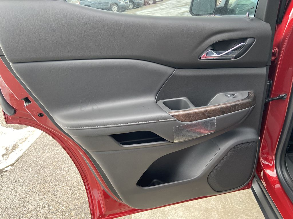 Red[Cayenne Red Tintcoat] 2021 GMC Acadia Denali Left Rear Interior Door Panel Photo in Calgary AB