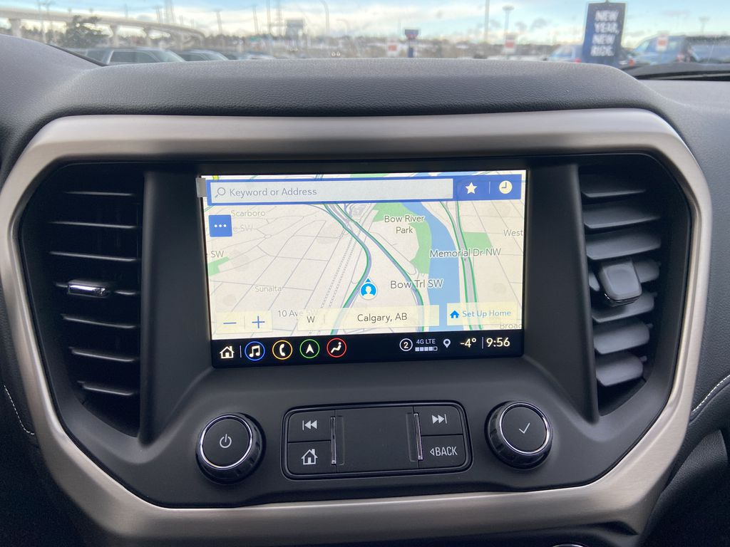 Red[Cayenne Red Tintcoat] 2021 GMC Acadia Denali Navigation Screen Closeup Photo in Calgary AB