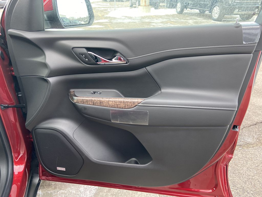 Red[Cayenne Red Tintcoat] 2021 GMC Acadia Denali Right Front Interior Door Panel Photo in Calgary AB