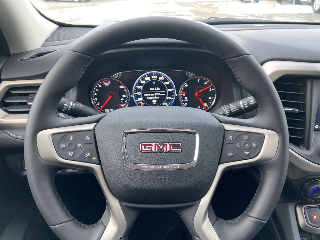 Red[Cayenne Red Tintcoat] 2021 GMC Acadia Denali Steering Wheel and Dash Photo in Calgary AB