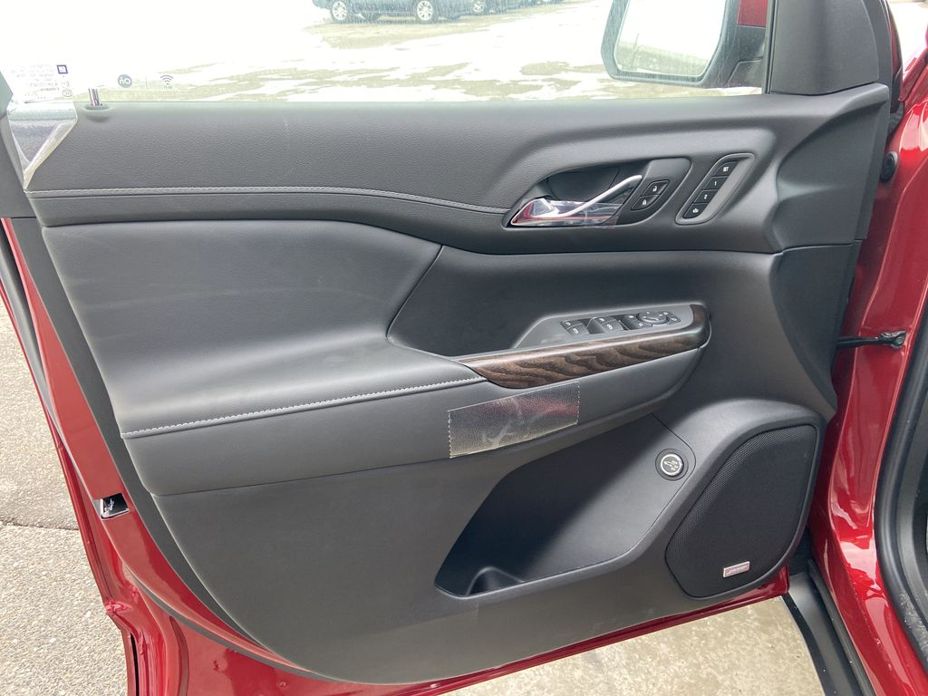 Red[Cayenne Red Tintcoat] 2021 GMC Acadia Denali Left Front Interior Door Panel Photo in Calgary AB