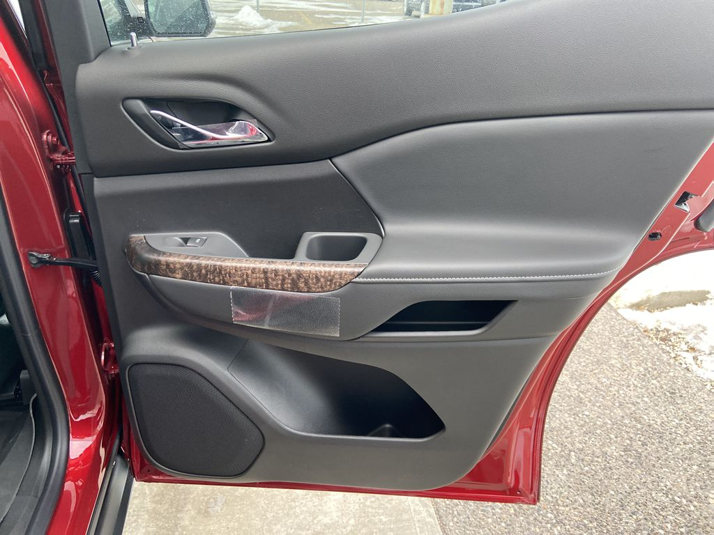 Red[Cayenne Red Tintcoat] 2021 GMC Acadia Denali Right Rear Interior Door Panel Photo in Calgary AB