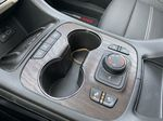 Red[Cayenne Red Tintcoat] 2021 GMC Acadia Denali Center Console Photo in Calgary AB