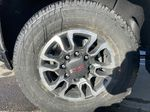 White[Summit White] 2021 GMC Sierra 2500HD SLE Left Front Rim and Tire Photo in Calgary AB