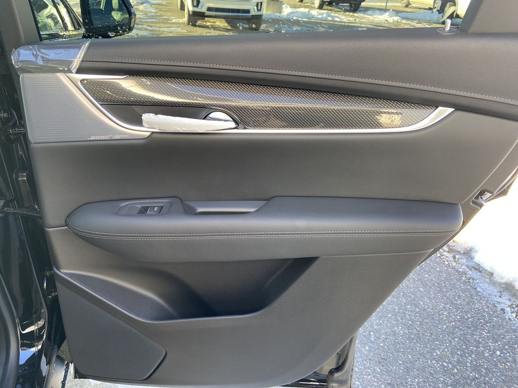 Black[Stellar Black Metallic] 2021 Cadillac XT5 Sport Right Rear Interior Door Panel Photo in Calgary AB