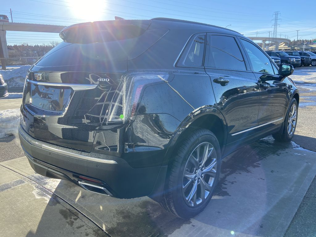 Black[Stellar Black Metallic] 2021 Cadillac XT5 Sport Right Rear Corner Photo in Calgary AB