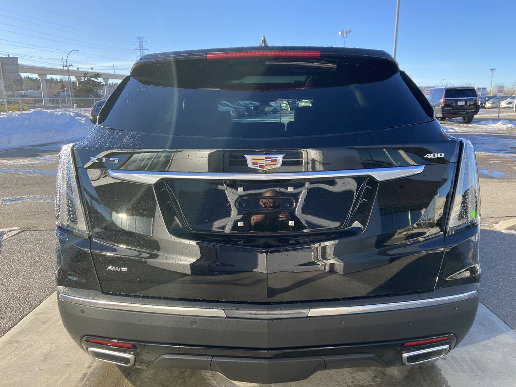 Black[Stellar Black Metallic] 2021 Cadillac XT5 Sport Rear of Vehicle Photo in Calgary AB