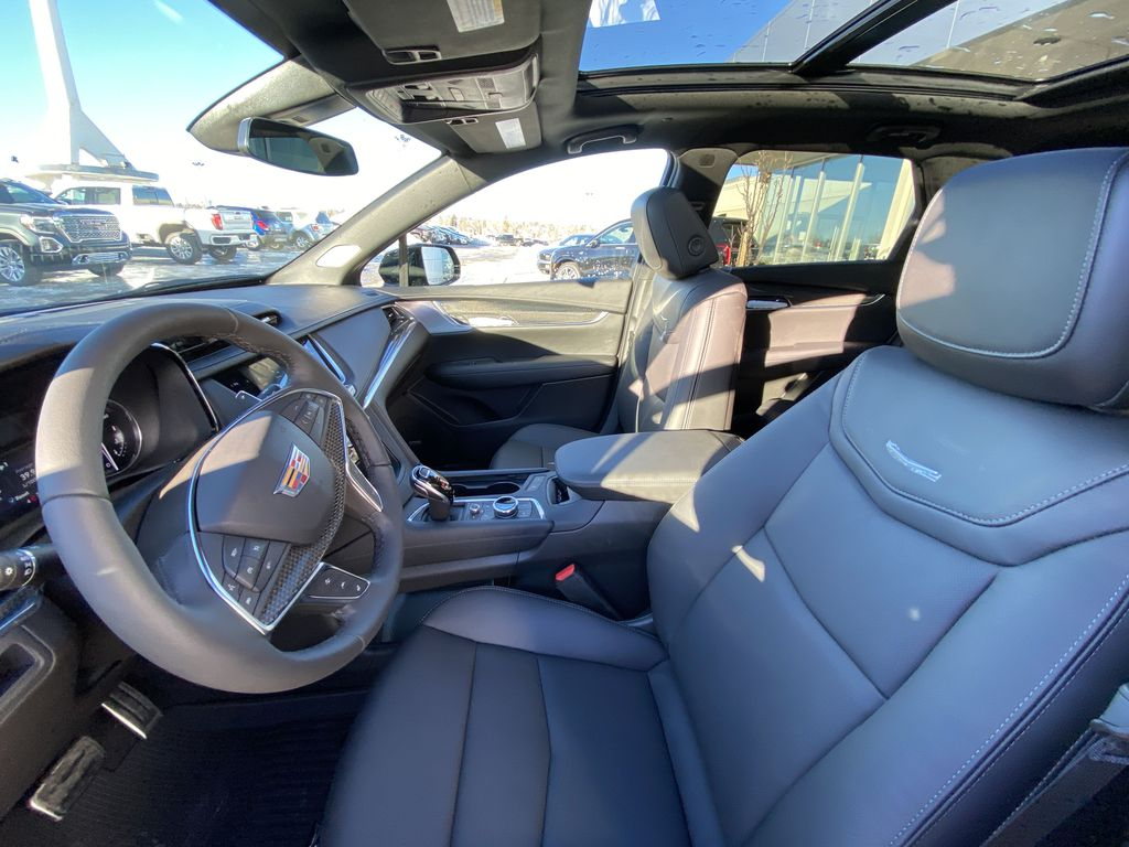 Black[Stellar Black Metallic] 2021 Cadillac XT5 Sport Left Front Interior Photo in Calgary AB