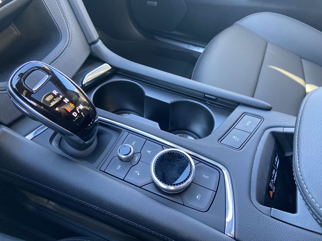 Black[Stellar Black Metallic] 2021 Cadillac XT5 Sport Center Console Photo in Calgary AB