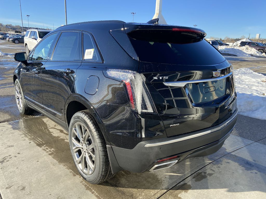 Black[Stellar Black Metallic] 2021 Cadillac XT5 Sport Left Rear Corner Photo in Calgary AB