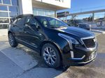 Black[Stellar Black Metallic] 2021 Cadillac XT5 Sport Right Front Corner Photo in Calgary AB