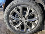 Black[Stellar Black Metallic] 2021 Cadillac XT5 Sport Left Front Rim and Tire Photo in Calgary AB