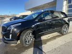 Black[Stellar Black Metallic] 2021 Cadillac XT5 Sport Left Front Corner Photo in Calgary AB