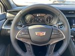 Black[Stellar Black Metallic] 2021 Cadillac XT5 Sport Steering Wheel and Dash Photo in Calgary AB