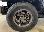 BLACK 2016 Jeep Wrangler Unlimited 75th Anniversary - NAV, Remote Start, Heated Seats Left Front Rim and Tire Photo in Edmonton AB