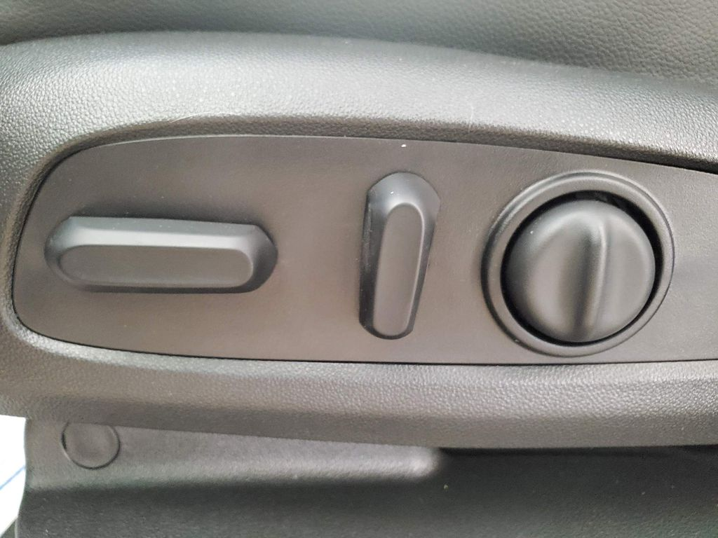Red 2021 Chevrolet Traverse Driver's Side Door Controls Photo in Airdrie AB