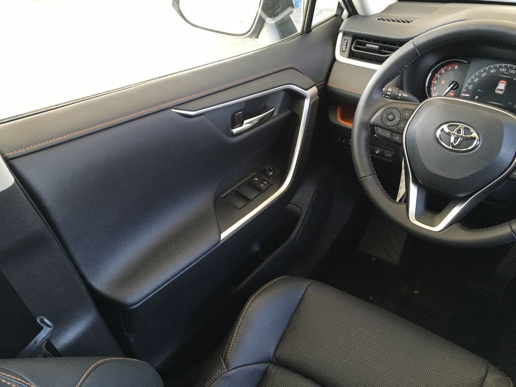 Gray[Lunar Rock/Ice Edge Roof] 2021 Toyota RAV4 Left Front Interior Door Panel Photo in Kelowna BC